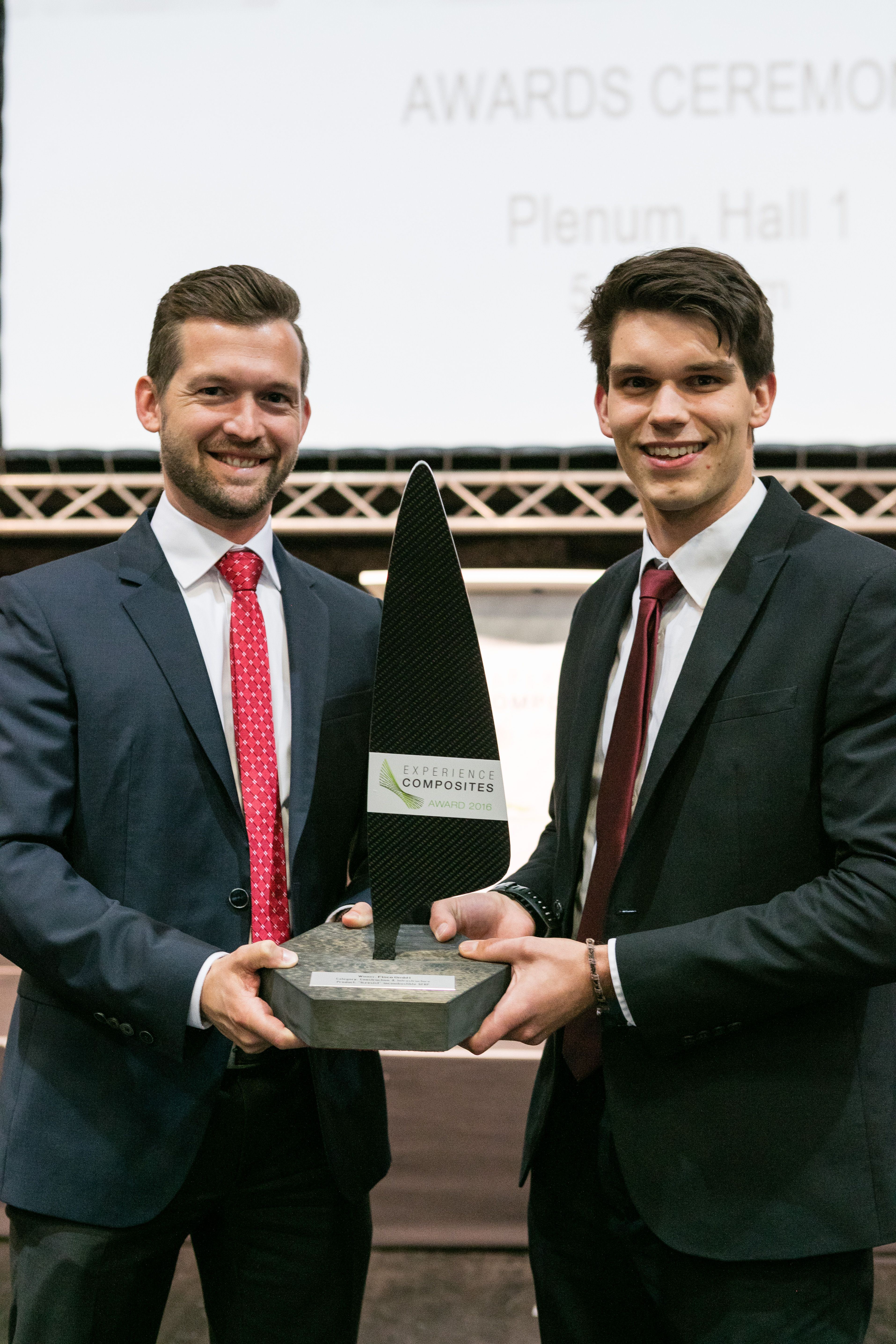 "Günther Hirt (Managing Director, left) and David Thull (Product Manager, right) receiving the ""Experience Composites Innovation Award powered by JEC"" for the development of fi:resist"